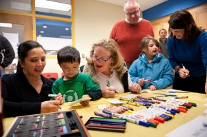 CEO Cathy Malloy (center) and First Selectman Mary Glassman (right) help kids create their mural pieces.